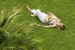 Middle Aged Woman Sleeping On Grass Stock Photos