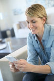 Middle-aged woman on smartphone Royalty Free Stock Images