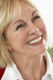 Middle Aged Woman Smiling Cheerfully royalty free stock images