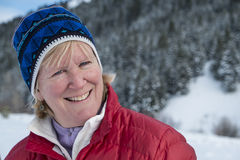 Middle aged woman in snow Royalty Free Stock Photos