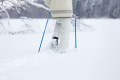 Middle-aged woman snowshoeing Stock Photography