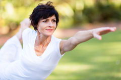 Middle aged woman stretching Stock Images
