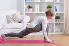 Middle aged woman stretching Stock Photo