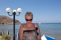 Middle-aged woman in sunglasses and Pare on the background of th Royalty Free Stock Photo