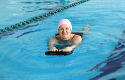 Middle Aged Woman in Swimming Pool stock image