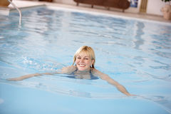Middle Aged Woman Swimming In Pool Stock Photos