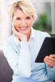 Middle aged woman tablet pc Royalty Free Stock Photo