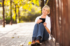 Middle aged woman tablet Royalty Free Stock Photography