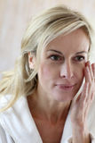 Middle-aged woman taking care of her skin Royalty Free Stock Photography