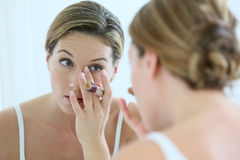 Middle aged woman taking care of her skin Royalty Free Stock Image