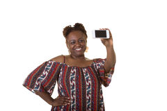A middle aged woman taking a photo Stock Photography