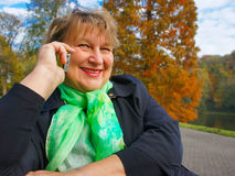 Middle-aged woman talking on the phone Stock Photography