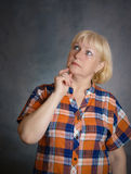Middle aged woman thinking. Stock Images