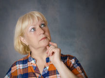 Middle aged woman thinking. Stock Image