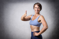 Middle aged woman with thumb up Royalty Free Stock Images