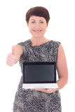Middle aged woman thumbs up with laptop Royalty Free Stock Photo