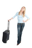 Middle aged woman with trolley bag Royalty Free Stock Photography