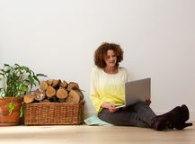 Middle aged woman using laptop at home Stock Image