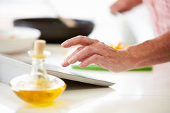 Middle Aged Woman Using Recipe On Digital Tablet Stock Image