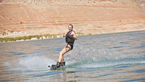 Middle-Aged Woman Wakeboarding Stock Photos