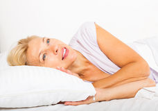 Middle-aged woman  waking on bed Royalty Free Stock Images