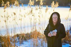 Middle aged woman walking in park on a winter day Stock Photography