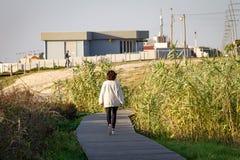 Woman Walks on Boardwalk stock photography