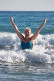 Middle-aged woman on the waves Royalty Free Stock Images