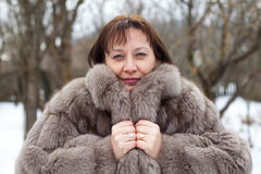 Middle aged woman wearing a mink coat Stock Image