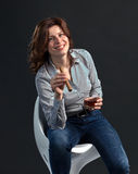 Middle aged woman with whiskey Stock Image