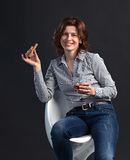 Middle aged woman with whiskey Stock Photos