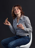 Middle aged woman with whiskey Stock Photography