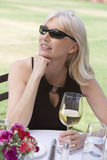 Middle Aged Woman With White Wine Outdoors Royalty Free Stock Photography