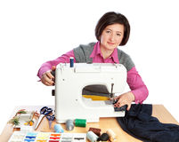 Middle-aged woman working at a garment factory. Stock Photography