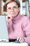 Middle-aged woman working on l Stock Photography