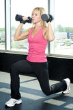 Middle aged woman working out with weights Stock Images