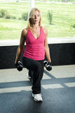 Middle aged woman working out with weights Royalty Free Stock Images