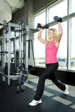 Middle aged woman working out with weights Stock Photos
