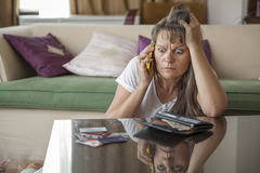 Middle aged woman worried over her finances Stock Photography