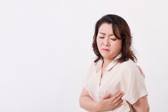 Middle aged woman worrying about breast cancer Stock Image