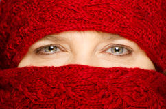 Middle-aged woman wrapped up in red scarf Stock Photo