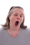 Middle-aged woman yawning Royalty Free Stock Photos