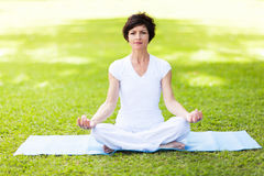 Middle aged woman yoga Royalty Free Stock Photos