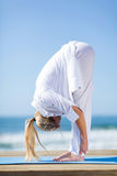 Middle aged woman yoga Stock Images