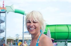 Middle-aged women. Portrait of middle-aged woman located at rest in the water park Stock Photo
