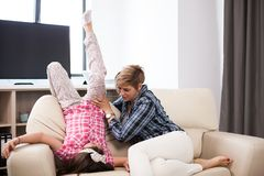 Middle aged woman on the couch with her teenage daughter. Middle aged women on the couch with her teenage daughter in the living room Stock Image