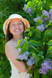 Middle-aged women and   lilac Royalty Free Stock Photos