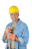 Middle aged Worker holding onto shovel handle Royalty Free Stock Photography