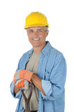 Middle aged Worker holding onto shovel handle Stock Photo