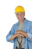 Middle aged Worker leaning on shovel Stock Photos